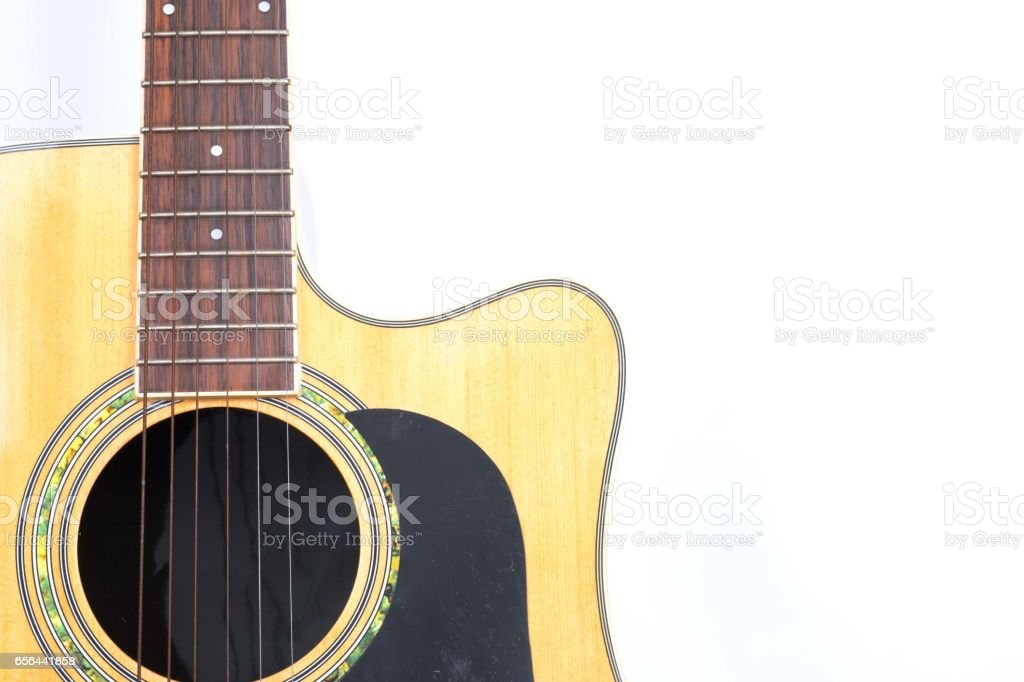 Acoustic guitar on white background stock photo