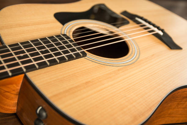 Acoustic guitar on wood background stock photo