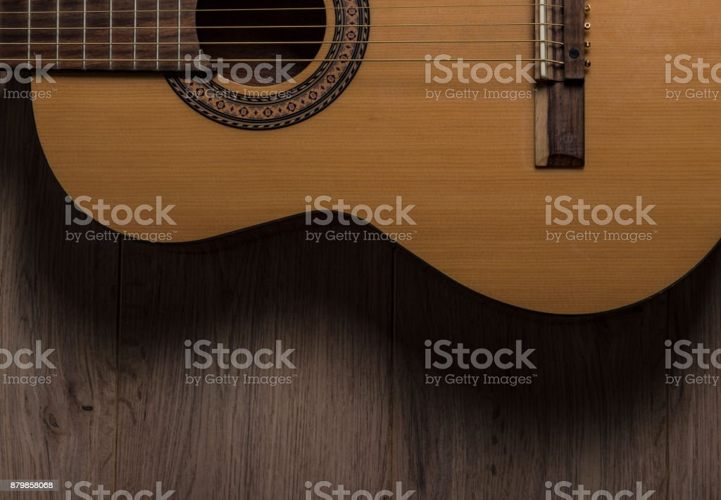 Acoustic Guitar on Wood stock photo