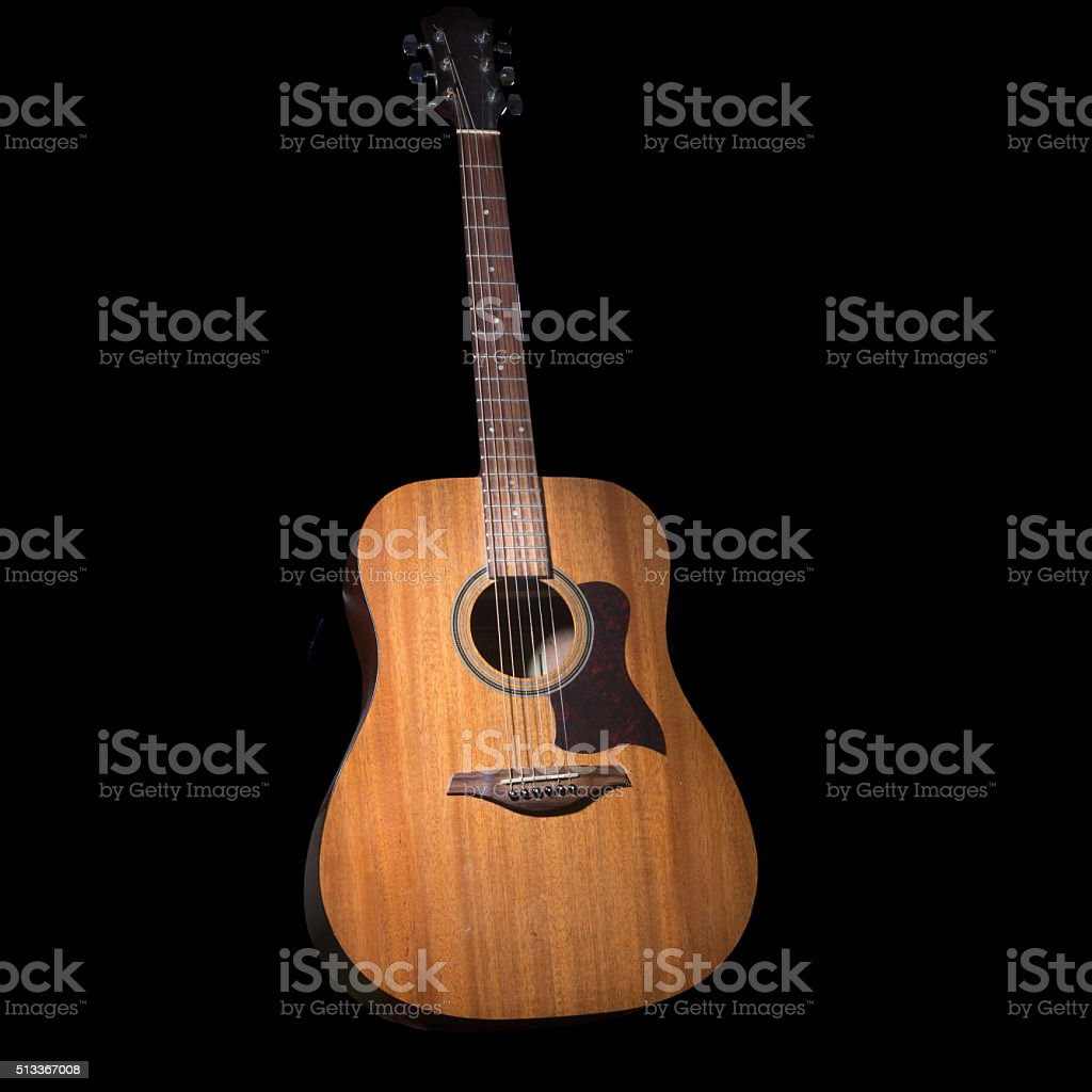 Acoustic guitar over black background stock photo