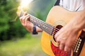 istock Acoustic Guitar Playing. 1263105417