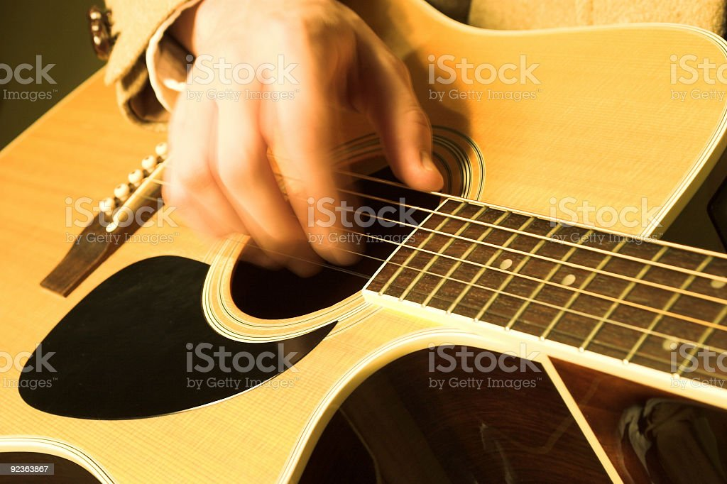 Acoustic Guitar - Playing w/ hand in motion royalty-free stock photo