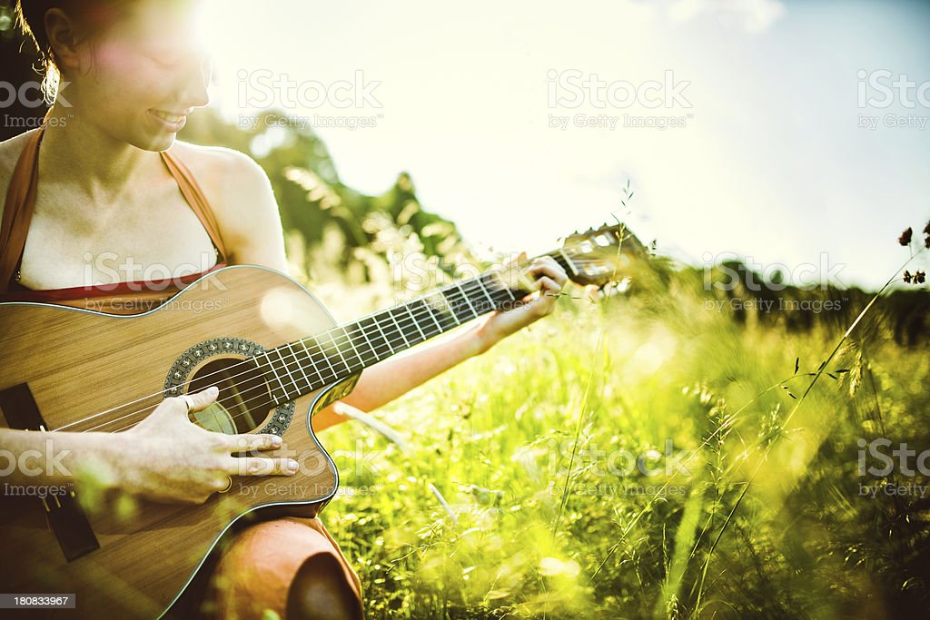Acoustic Guitar Playing Young Woman royalty-free stock photo