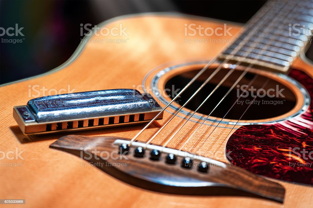 Acoustic guitar with blues harmonica country stock photo
