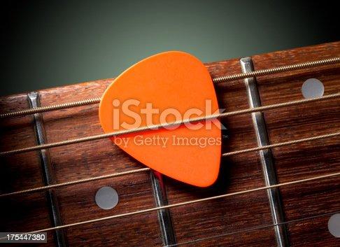 Acoustic guitar with pick. Acoustic guitar with pick.Similar photographs from my portfolio: