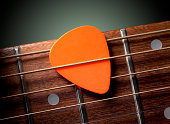 Acoustic guitar with pick. Acoustic guitar with pick.Similar photographs from my portfolio: