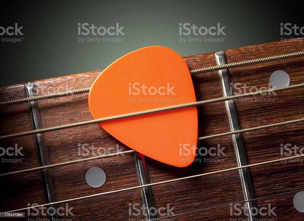 Acoustic guitar with pick stock photo