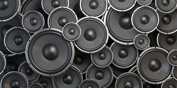 Acoustic sound speakers background. Black subwoofers of different size. Multimedia, audio and sound concept. stock photo