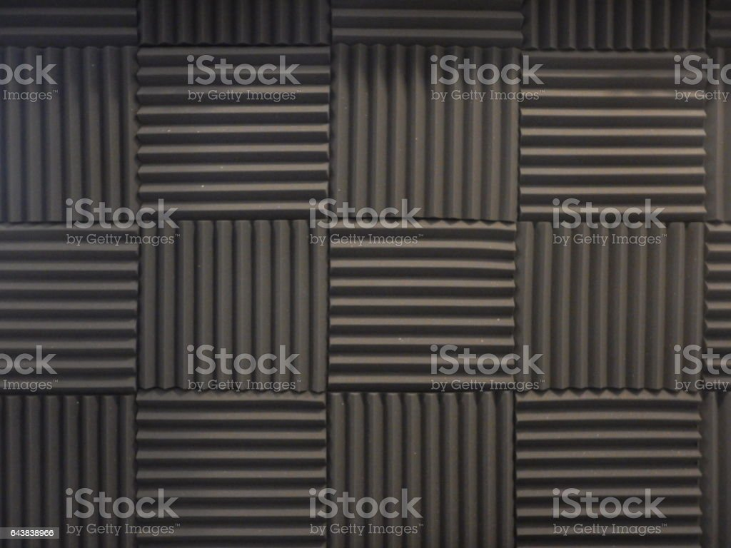 Acoustical foam or tiles for sound dampening. Music room. Soundproof room. Low key photo. stock photo