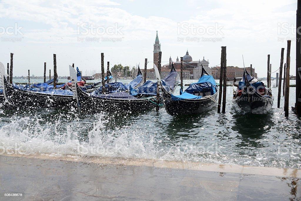 Acqua alta floods gondola parking in Venice, Italy stock photo