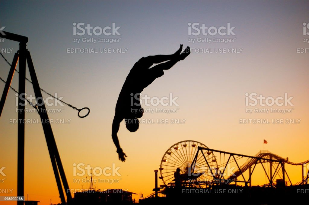 Acrobat Flies From the Rings in Santa Monica at Sunset - Royalty-free Acrobat Stock Photo