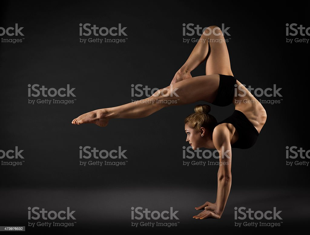 Acrobat Performer, Circus Woman Hand Stand, Gymnastics Back Bend Pose stock photo