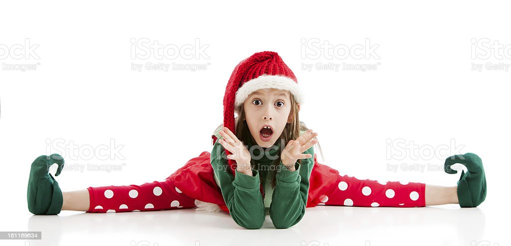 Acrobatic Female Chrismtas Elf Looks Suprised Doing Splits stock photo