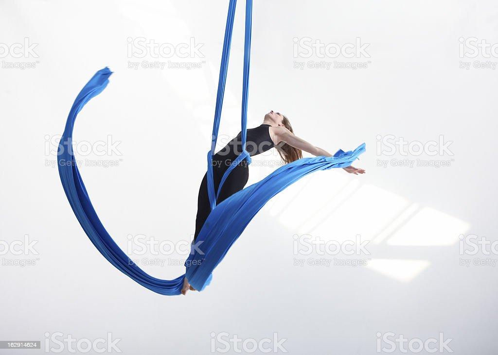 Acrobatic movement with tissue stock photo