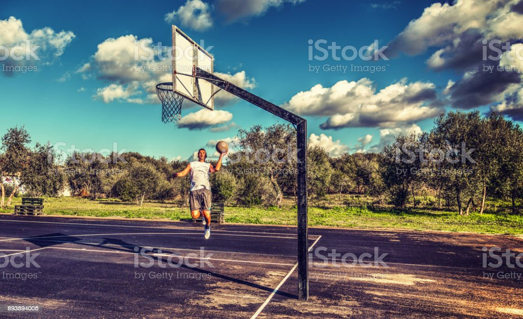 Acrobatic shot in a basketball playground stock photo