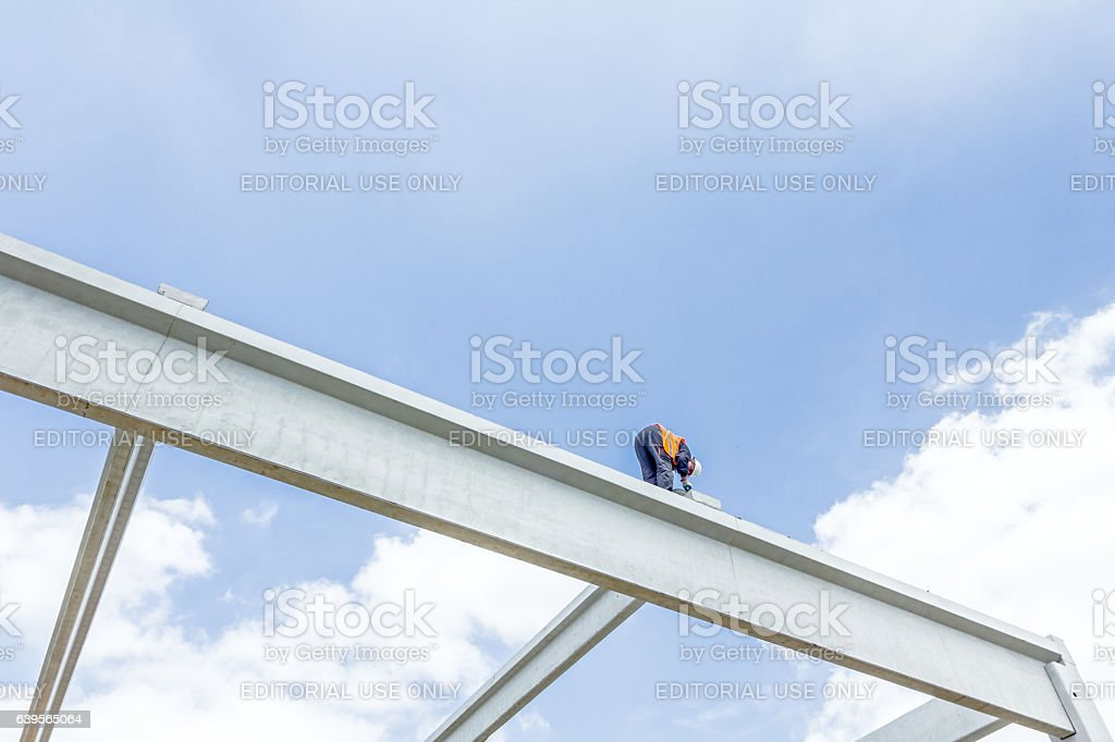 Acrobatic work at construction site stock photo