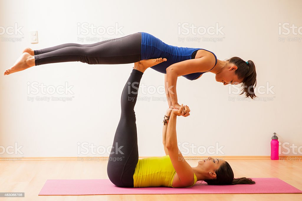 Acrobatic yoga in a gym stock photo