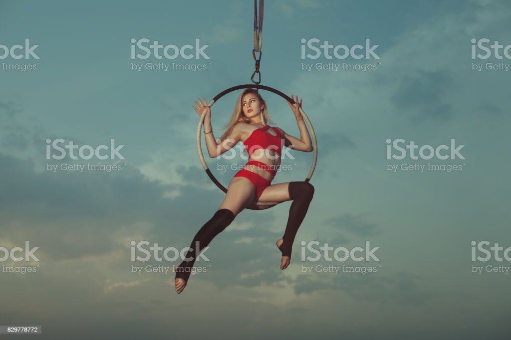 Acrobatics on a hoop the background of the sky. stock photo