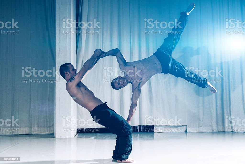 Acrobats use skills and muscles to perfom stock photo