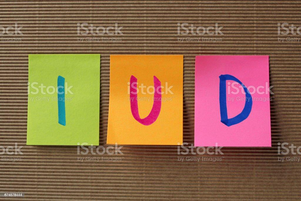 IUD acronym on colorful sticky notes stock photo