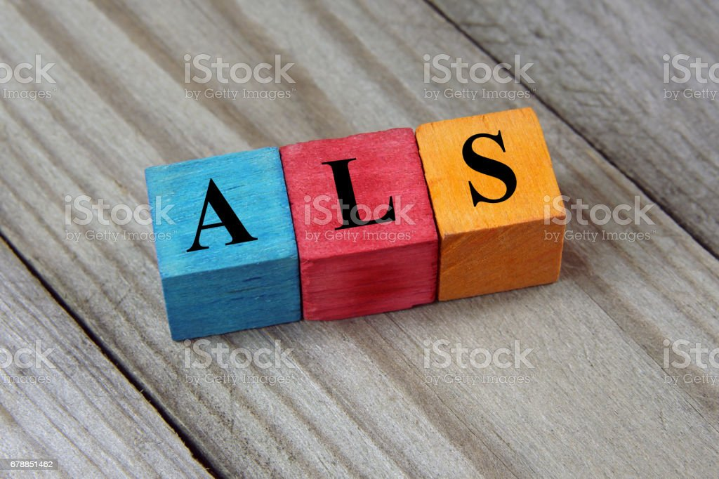 ALS acronym on colorful wooden cubes stock photo