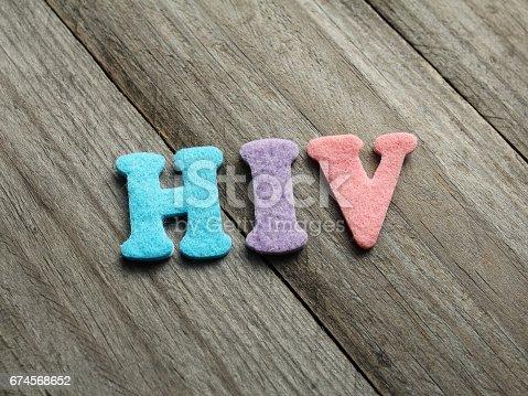 istock HIV acronym on wooden background 674568652