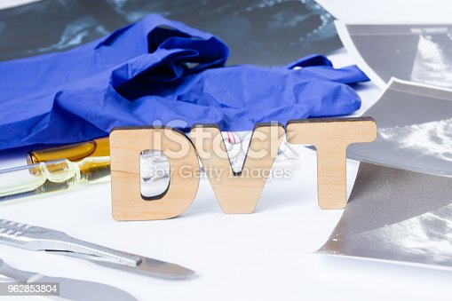 istock DVT Acronym or abbreviation of deep vein thrombosis, blood clot in vein inside our body. Photo concept of diagnosis, treatments and prevention of deep vein thrombosis - word DVT near medical items 962853804