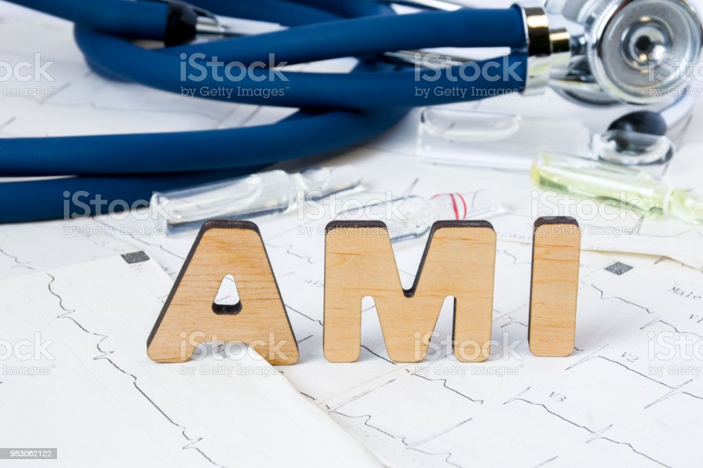 AMI Acronym or abbreviation to medical concept or diagnosis of acute myocardial infarction or heart attack. Word AMI letters stands on sheets of ECG on background of stethoscope and medicines stock photo