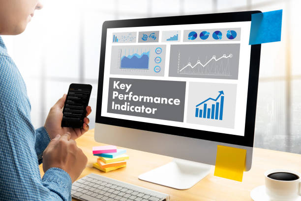 Acronyme KPI (Key Performance Indicator) Plan d'affaires main travail - Photo