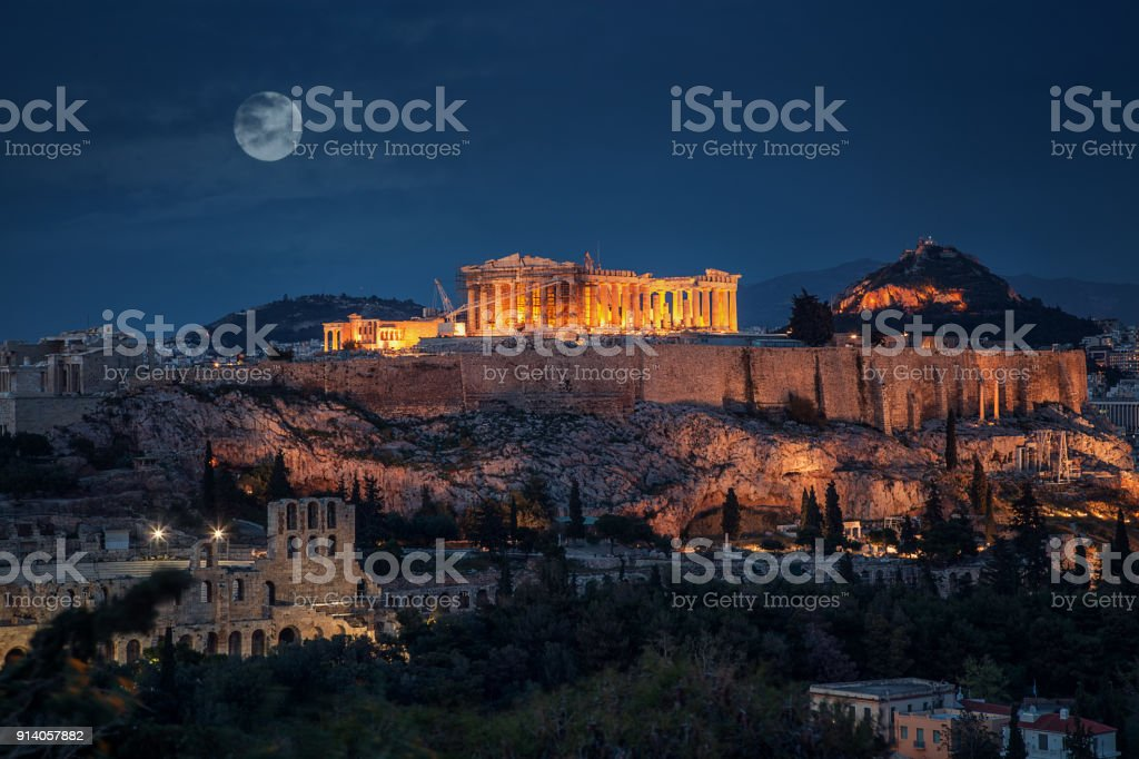 Acropolis at night with full moon Greece stock photo