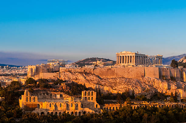 Acropolis Hill, Parthenon, Athens, Greece. Odeon Herodes Atticus. Golden Twilight.​​​ foto