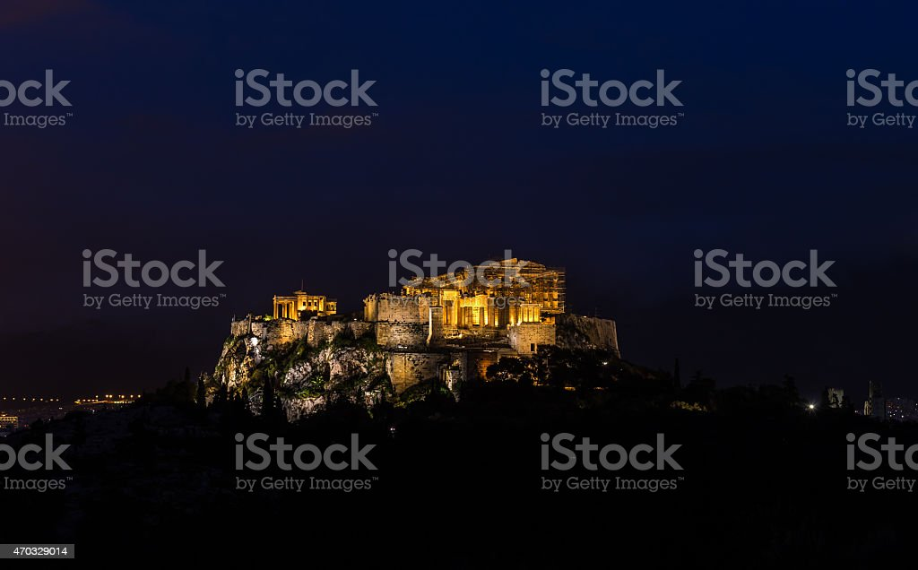 Acropolis hill with lighted Parthenon during the night stock photo