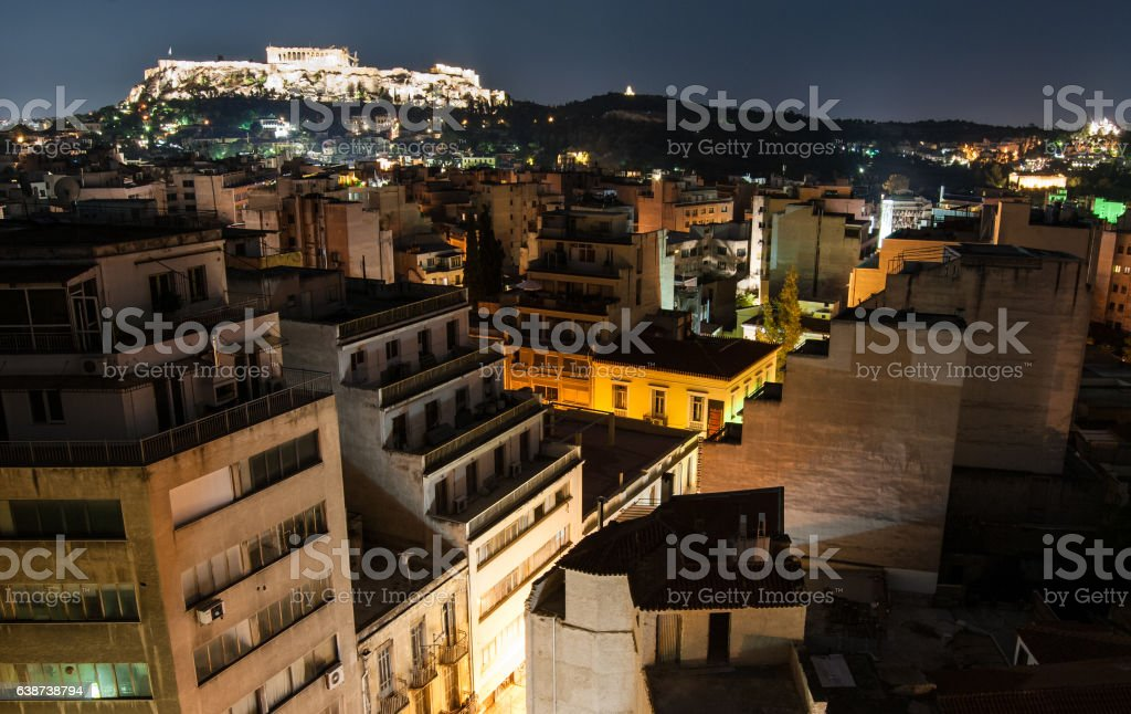 Acropolis of Athens at night with the illuminated city, Athens. stock photo