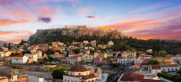 Acropolis of Athens at sunset and the old city in the foreground stock photo