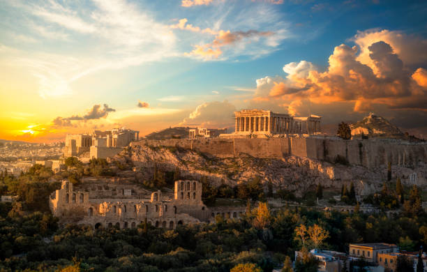 Acropolis of Athens at sunset with a beautiful dramatic sky Acropolis of Athens at sunset with a beautiful dramatic sky antediluvian stock pictures, royalty-free photos & images