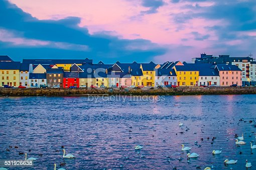 Shot from the Claddagh area looking straight across Galway Harbor into Old Galway Town with it's Pastel building and swans.
