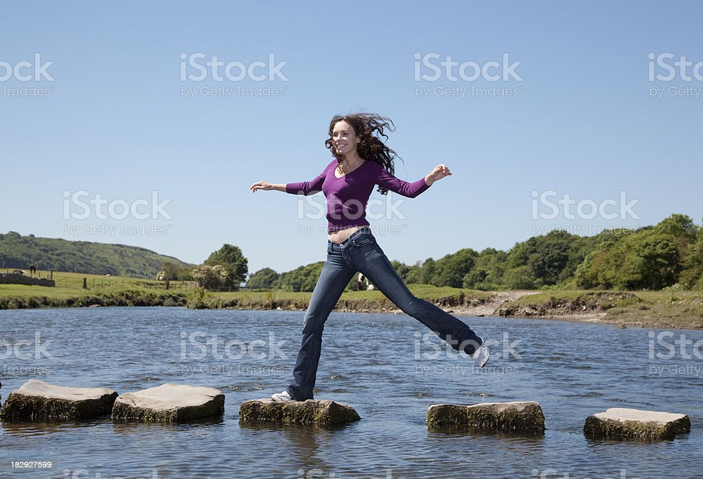 across stepping stones stock photo