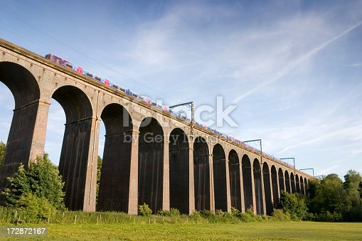 A commuter train crosses the Welwyn Viaduct that transverses the River Mimram valley in Hertfordshire, England. It is 1560 ft long, 475 metres, and comprises 40 arches standing 100 ft, 30metres, high. It was designed by William Cubitt, and opened by Queen Victoria in 1850.