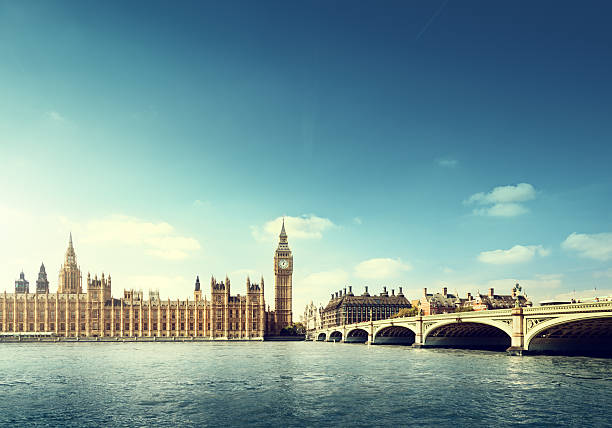 Across the water view of Big Ben in London on a sunny day Big Ben in sunny day, London city of westminster london stock pictures, royalty-free photos & images
