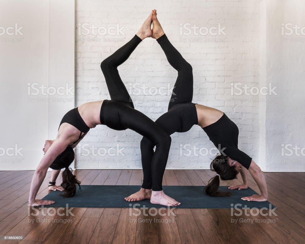Acroyoga duo: Full wheel pose - Urdhva Dhanurasana stock photo