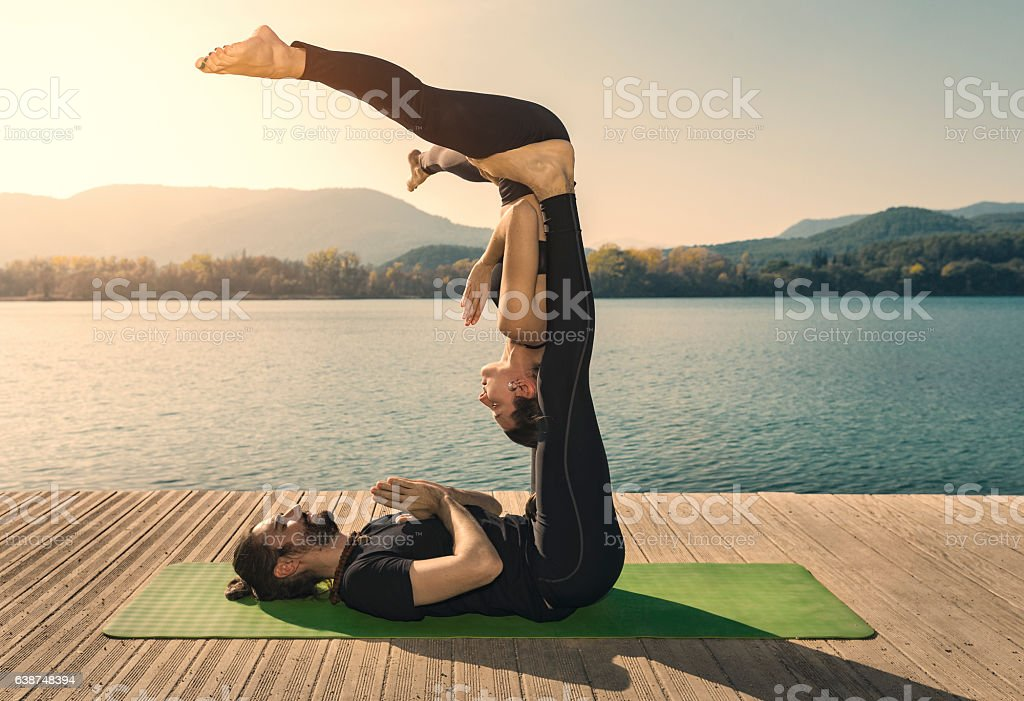Acroyoga straddle bat pose - Photo