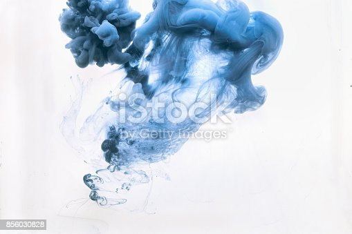 istock Acrylic blue color paints in the water 856030828