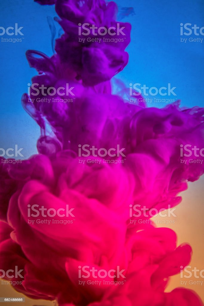 Acrylic colors and ink in water. Abstract frame background. Isolated on white royalty-free stock photo