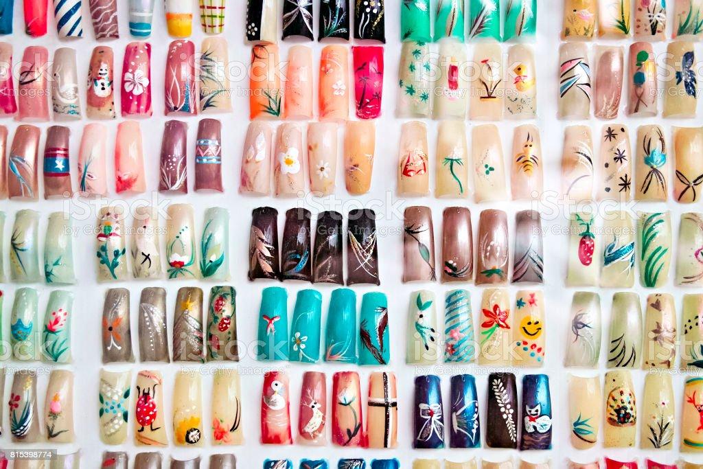 Acrylic fingernails on display stock photo