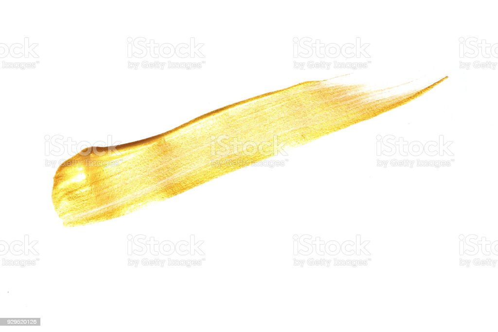 Acrylic gold paint on a white background. stock photo