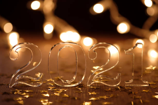 2021 acrylic numbers on bokeh background in golden colors stock photo
