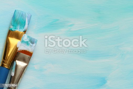 649470770 istock photo acrylic painted canvas with paintbrushes 175200654
