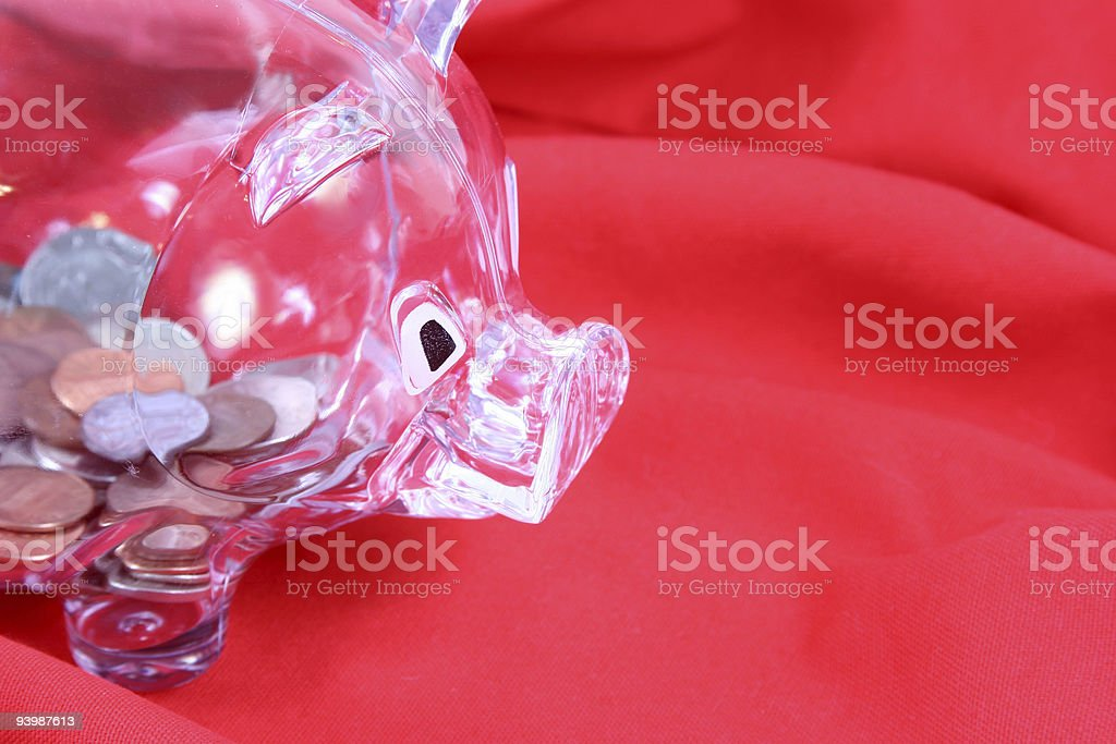 Acrylic Piggy bank on red background. royalty-free stock photo