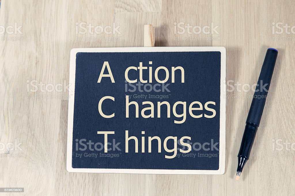 Action Changes Things written with chalk on a blackboard stock photo
