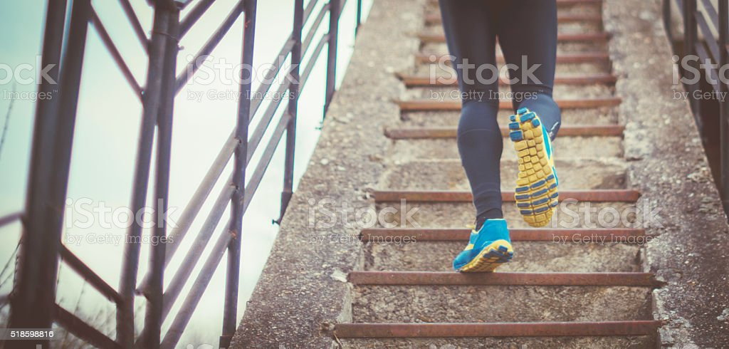 action closeup of man running on steps stock photo